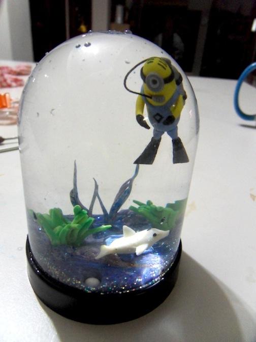 creating a diving minion snow globe design
